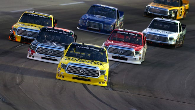 SPARTA, KY - JUNE 26:  Kyle Busch, driver of the #51 Dollar General Toyota, leads a pack of trucks during the NASCAR Camping World Series UNOH 225 at Kentucky Speedway on June 26, 2014 in Sparta, Kentucky.  (Photo by Christian Petersen/Getty Images)