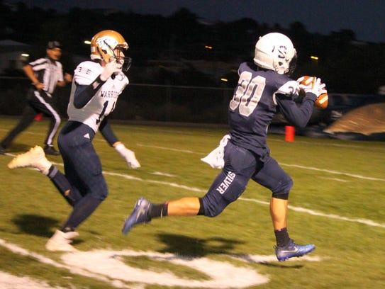 Steven Cross catches this pass en route to the first