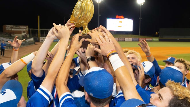 Van Cleave players celebrate with the trophy following the Bulldogs 3-0 win against New Hope in the MHSAA 4A Baseball Championships held at Trustmark Park Friday May 18, 2018.(Bob Smith)