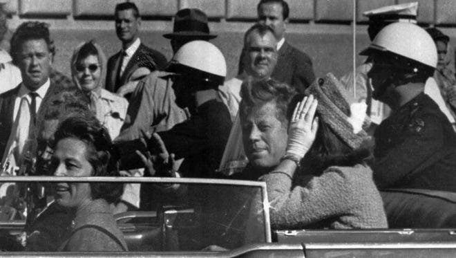 President John F. Kennedy rides in a motorcade with his wife Jacqueline moments before he was shot and killed in Dallas, Tx., Nov. 22, 1963.