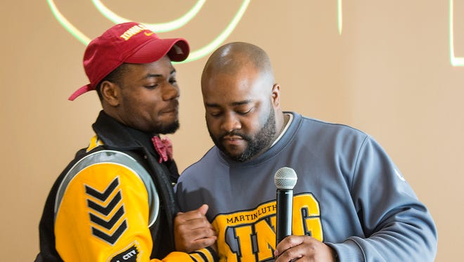 Detroit Public Schools standout football player Jaeveyon Morton from, Detroit King, and is signing with Iowa State is introduced by his coach Tyrone Spencer as they participate in signing day Wednesday Dec. 20, 2017 at the Horatio Williams Foundation in Detroit.