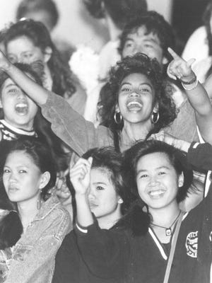 Simon Sanchez Sharks fans, with basketball star Frida Garcia at bottom right, cheer for the home team during a boys basketball game in this photo from the early 90s.