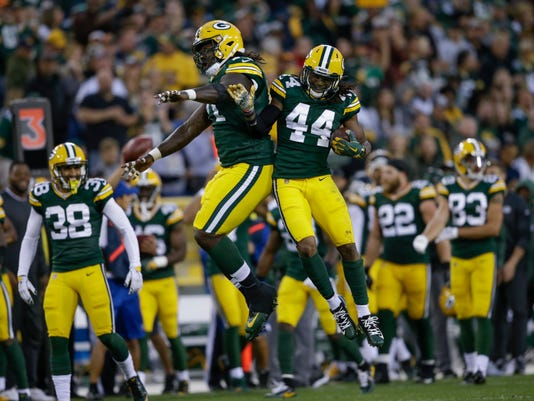 Green Bay Packers' Donatello Brown (44) celebrates his interception with teammate Izaah Lunsford during the first half of a preseason NFL football game against the Los Angeles Rams Thursday, Aug. 31, 2017, in Green Bay, Wis. (AP Photo/Jeffrey Phelps)