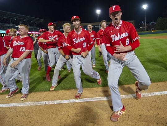 Fishers High School players celebrate after winning