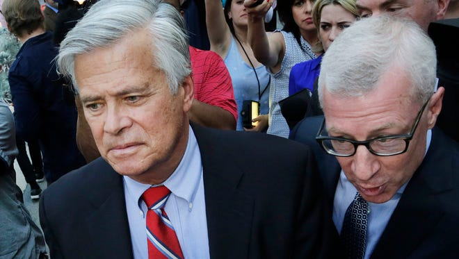 New York Senate Majority Leader Dean Skelos, center, leaves federal court, Monday, May 4, 2015, in New York. Skelos and his son were arraigned on charges including extortion and soliciting bribes amid a federal investigation into the awarding of a $12 million contract to a company that hired his son.