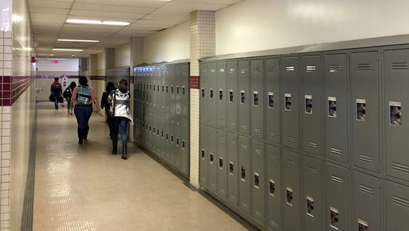 Students walk down an Andress High School hallway.