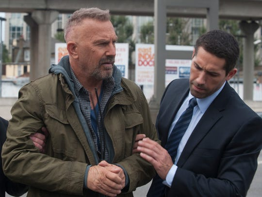 "Kevin Costner (left) and Scott Adkins star in ""Criminal."""