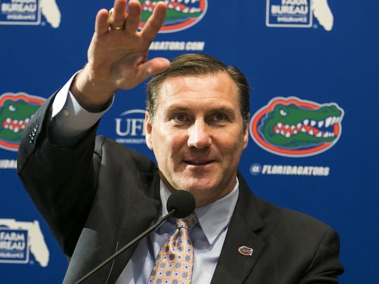 FILE - In this Nov. 27, 2017, file photo, Dan Mullen, the new head football coach at the University of Florida, is introduced during a news conference in Gainesville, Fla.  Mullen has told everyone who would listen his plan to return the Gators to national prominence. Now, he gets to show it. Florida opens spring practice Friday with hopes of finally fixing an offense that has been dormant for nearly a decade. (Alan Youngblood/Star-Banner via AP, File)