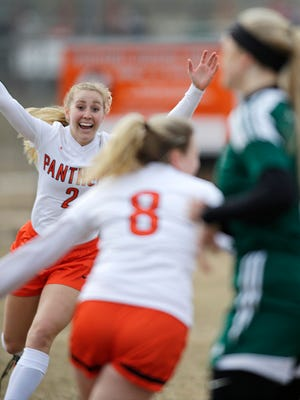 Plymouth's Jayda Martell (2) and Hannah Stucke (8) celebrates a goal against Kettle Moraine Lutheran, Tuesday, April 10, 2018 in Plymouth, Wis.