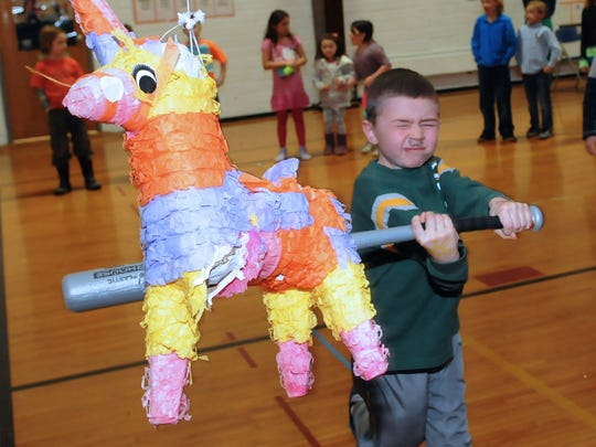 Tina says: The expression on this young boy's face was priceless. Henry Annen closes his eyes and takes a good whack at a piñata during the taco dinner and dance celebrating Spanish heritage at Gibraltar School on March 1.