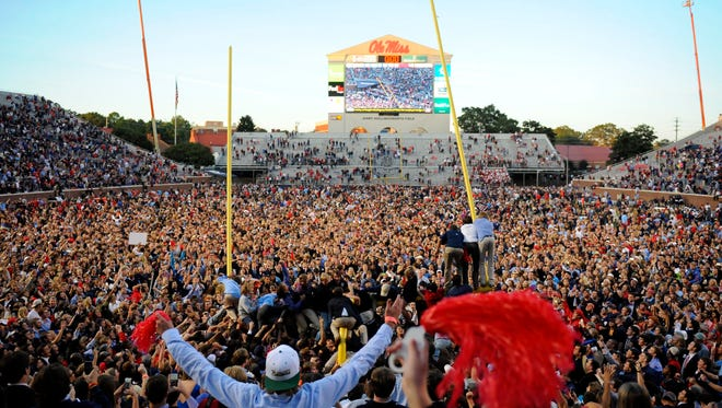 Ole Miss fans flood the field after beating Alabama in 2014.