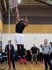 Southern Utah University basketball player Jamal Aytes tests his jumping height during the SUU Pro Day at Desert Hills High School in St. George Tuesday March 27, 2018.