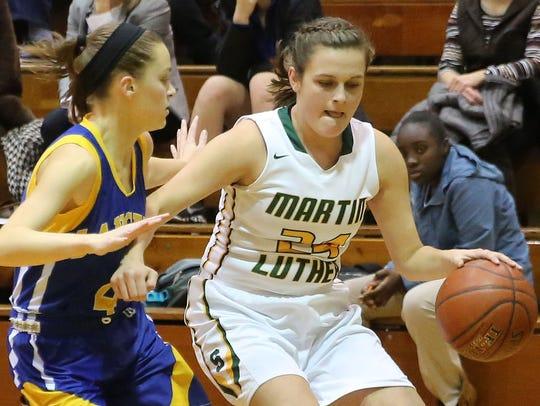 Martin Luther's Emily Hafemann drives around a defender