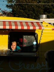 Michael Morey sits in his food truck for EZ Cheesy business at The Little Fleet food truck park/bar in downtown Traverse City on Tuesday September 22, 2015.
