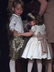 Prince George, a pageboy,  and Princess Charlotte,