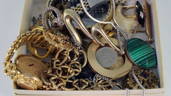 A box of jewelry before it gets a spring makeover.