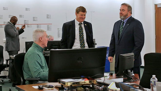 Green Bay Packers general manager Ted Thompson (left), President Mark Murphy and coach Mike McCarthy visit with each other inside the war room during a recent NFL draft at Lambeau Field.