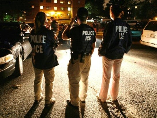 2010-11-15-ice-agents-look-on-as-gang-member-arrested-during-community-shiel