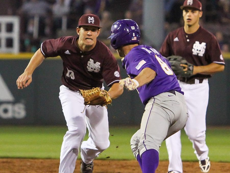 Mississippi State second baseman tries to tag out an LSU player.