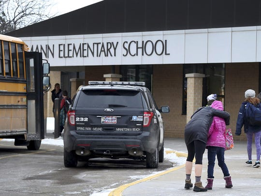 Meghan Stephenson hugs her child before staying goodbye outside Orono Schumann Elementary School on Feb. 22, in Orono, Minn. A threat sent schools into lockdown the day before, part of a copycat wave after the massacre a week earlier in Parkland, Fla.