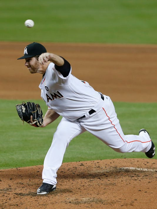 Miami Marlins' Dillon Peters delivers a pitch during the fourth inning of a baseball game against the Philadelphia Phillies, Friday, Sept. 1, 2017, in Miami. (AP Photo/Wilfredo Lee)