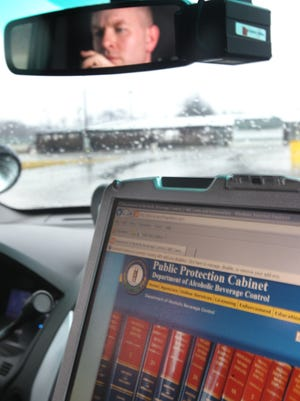 Boone and Kenton counties have moved all warrants and protective orders online, allowing officers to access the information via the MDT (Mobile Data Terminals) in their vehicles.  Boone County deputy sheriff S. Freeman now has the information at his fingertips.
