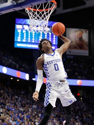 Kentucky Wildcats guard De'Aaron Fox (0) dunks the ball against the Asbury Eagles in the second half at Rupp Arena. Kentucky defeated Asbury 156-63.