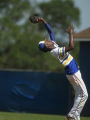 Rickards pitcher Javon Peterson makes an infield catch during the Region 1-5A final against Bolles.