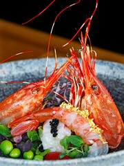 Ama ebi nigiri, sweet shrimp, is served with the fried head, a striking presentation at Hungry Sumo.