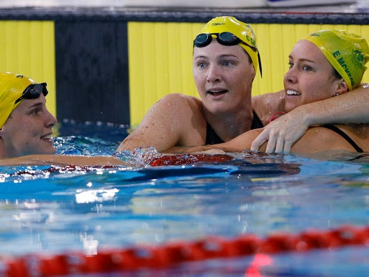FILE - In this July 28, 2014, file photo, Cate Campbell who won gold, center, celebrates with Emma McKeon, the bronze winner, right, and Bronte Campbell, silver winner, left, all of Australia, after the Women's 100m Freestyle final at the Tollcross International Swimming Centre during the Commonwealth Games 2014 in Glasgow, Scotland. Along with David McKeon the Brisbane-based McKeons and Campbells are two of seven sibling combinations already named on the Australian Olympic team to compete at the Rio de Janeiro Games in August. (AP Photo/Kirsty Wigglesworth, File)