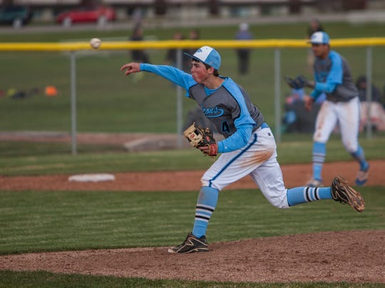 Canyon View's Cadyn Clark throws a pitch during the game at Cedar High, Thursday, Mar. 31, 2016.