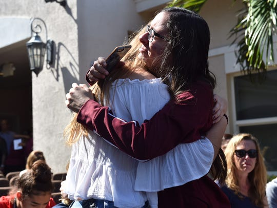 Friends embrace Thursday, Feb. 15, 2018, in tears at the Parkridge Church in Coral Springs before the start of a community prayer vigil for Marjory Stoneman Douglas High School shooting victims.