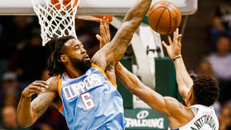 Clippers center DeAndre Jordan blocks a shot by Bucks forward Giannis Antetokounmpo in the first half of their NBA game at the BMO Harris Bradley Center on Wednesday.