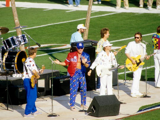 Super Bowl XXI: The Beach Boys perform during pre-game prior to the Super XXI between the New York Giants and the Denver Broncos at the Rose Bowl. The Giants defeated the Broncos 39-20. The halftime theme, a Salute to Hollywood's 100th Anniversary-The World of Make Believe, featured George Burns, Mickey Rooney, Grambling State University and USC marching bands, Disney characters and Southern California-area high school drill teams and dancers.