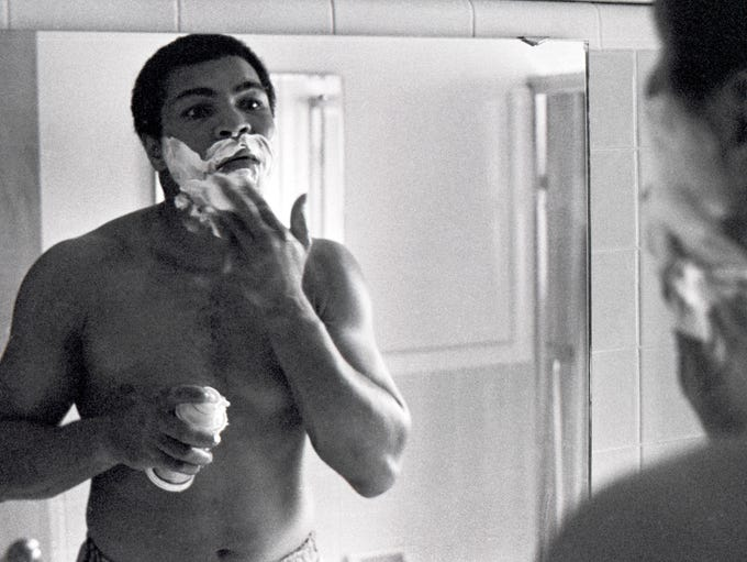 Ali shaving at his home in Louisville in 1978.