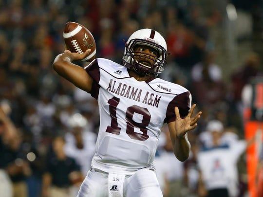 Alabama A&M Bulldogs quarterback De'Angelo Ballard (18).