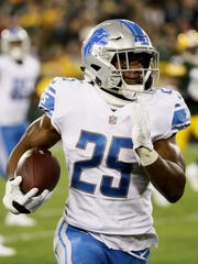 Theo Riddick gains 63 yards against the Packers.
