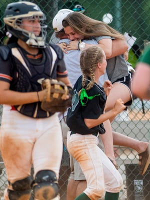 Injured Edgewood player Faith Wheat is hugged as Edgewood  defeats Glenwood for the AISA AAA state softball championship at Lagoon Park in Montgomery, Ala., on Saturday May 5, 2018.