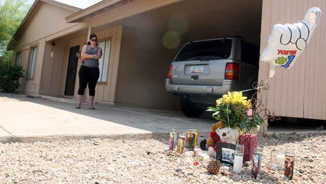 Carolina Viniegra visits the memorial site where 16-year-old Miguel Navarro was shot and killed Sunday.