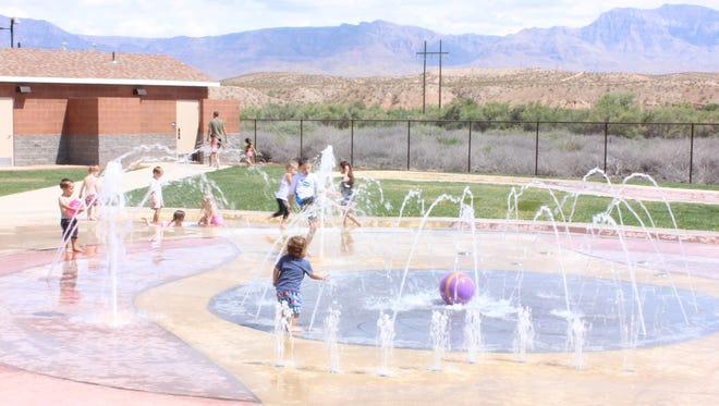Children play at the splash pad at Hafen Park last summer.