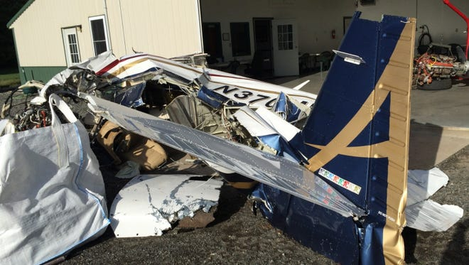 The airplane flown by Gaylord Dr. Michael Moir, Mooney N370MM, was recovered from a depth of about 45 feet in the Atlantic Ocean.