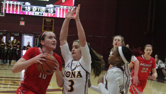 Marist's Maura Fitzpatrick (10) goes up for a shot attempts while being guarded by Iona's Kristin Mahoney (3) and Philecia Atkins-Gilmour (11) during a college women's basketball game between Iona and Marist at the Hynes Center in New Rochelle on Sunday, January 15th, 2017. Marist won 68-62.
