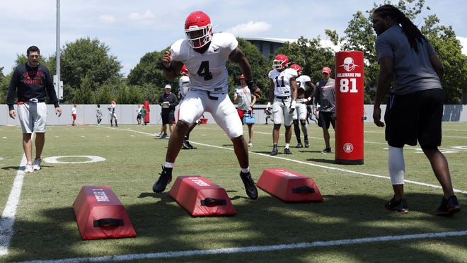 Georgia linebacker Nolan Smith (4), of Savannah, runs a drill with Jarvis Jones, right, and Georgia defensive coordinator Dan Lanning during a preseason practice in Athens on Aug. 8, 2019.