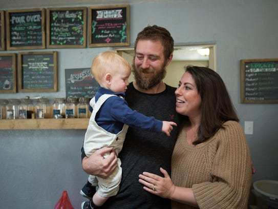 Arianna Parsons with her husband Tyrell Thacker and their 10 month old Thomas, are the owners of Beck's Roasting House and Creamery, Wednesday January 10, 2018.