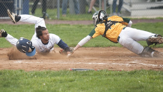 Dylan Maria, left, scores a run for Highland during the 2017 season. Maria is one of four South Jersey graduates on the La Salle baseball program, which it was announced on Tuesday would be terminated following the academic year.