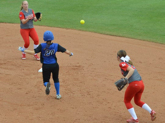Hermleigh second baseman Kami Smith (far right) relays a throw to shortstop Lillyan Digby ahead of Slocum's Shelby Bowman (20) in the third inning of Saturday's Class 1A state championship game at McCombs Stadium in Austin.