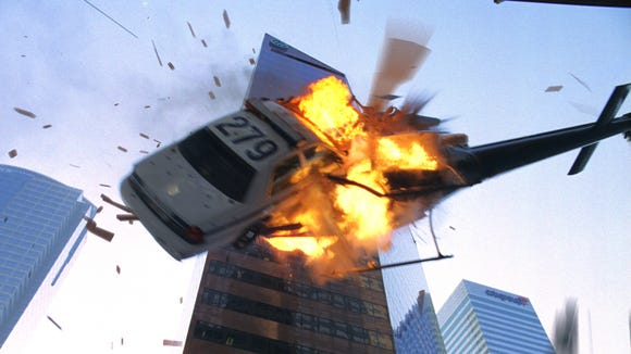 "A police car and a helicopter collide in ""Live Free or Die Hard,"" the fourth film in the franchise."