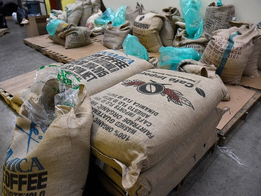 Bags of fresh coffee are ready for the roasting process Tuesday, Nov. 24, at Muggsy's Beans in St. Cloud.