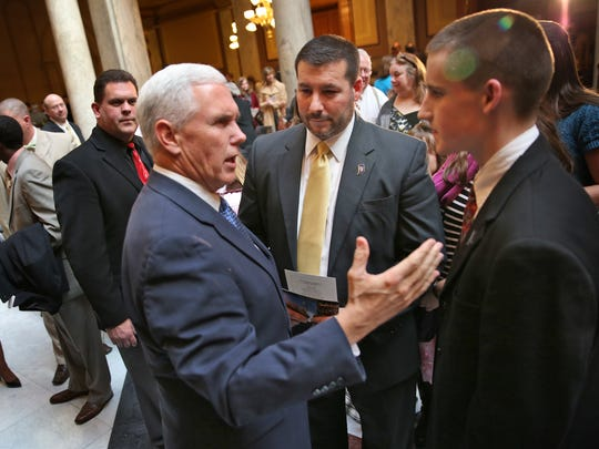 Governor Mike Pence, from left, talks with Bloomington pastor Brian Stewart and his son Jordan Stewart after the 12th Annual Statehouse Prayer Service on the first day of the 2016 session, Tuesday, January 5, 2016.  Jordan Stewart just joined the Marines and will be heading out in May.