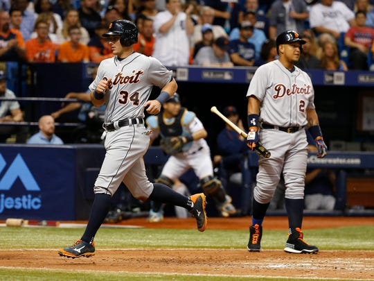 Tigers catcher James McCann (34) scores a run on a wild pitch during the seventh inning of  the Tigers' Friday win.